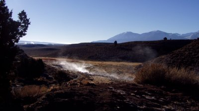 Little Hot Creek steaming in the morning, with steam from Big Hot Creek in the background