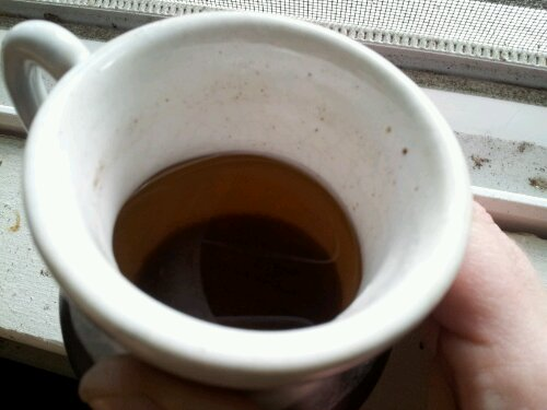 coffee cup with pale brown liquid